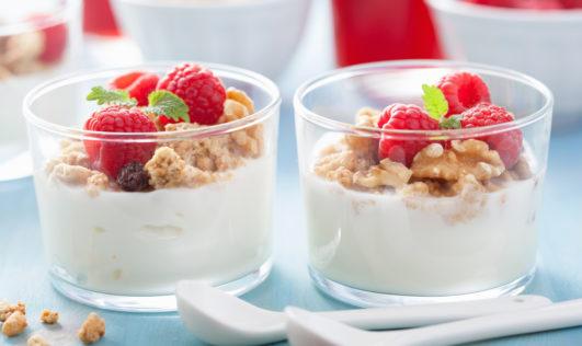 A healthy granola raspberry yoghurt breakfast