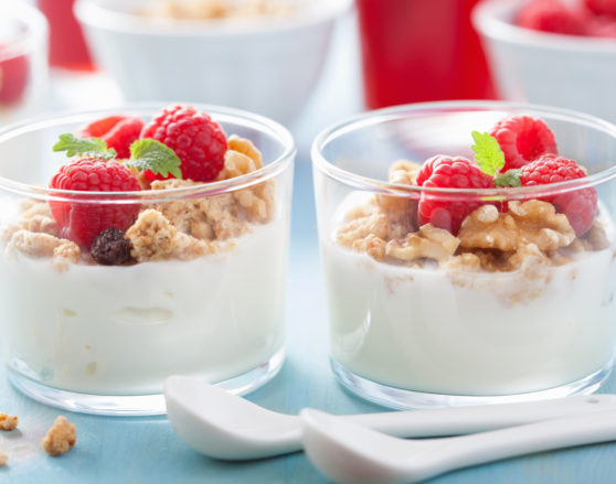 A healthy granola raspberry yoghurt breakfast