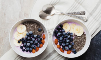 Breakfast from yogurt with berries, banana, almonds and chia seeds